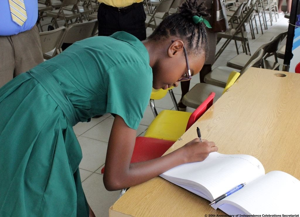 Head Girl of the Seventh-Day Adventist Primary School, Brianna Hardy signing the Pledge Book. (S.Medford)