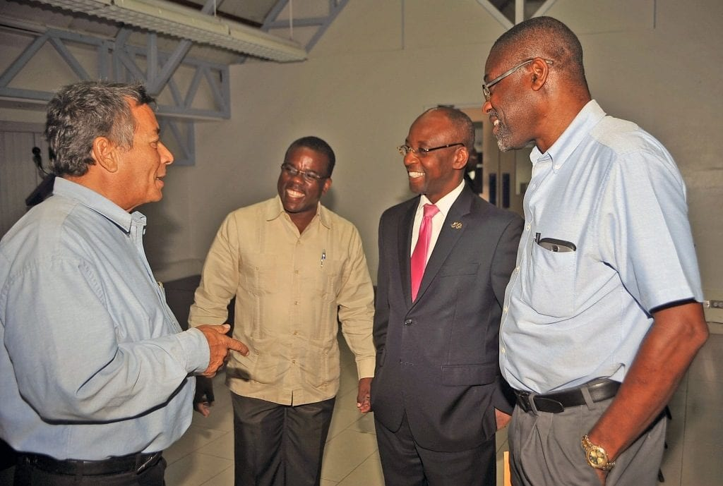 Minister of Youth, Stephen Lashley (second right) chatting with (left to right) YMCA Board Member, Edmund Bradshaw; President, Antonio Elcock; and Board Member, Orson Simpson at the organisation's 136th Annual General Meeting yesterday. (A.Miller/BGIS)