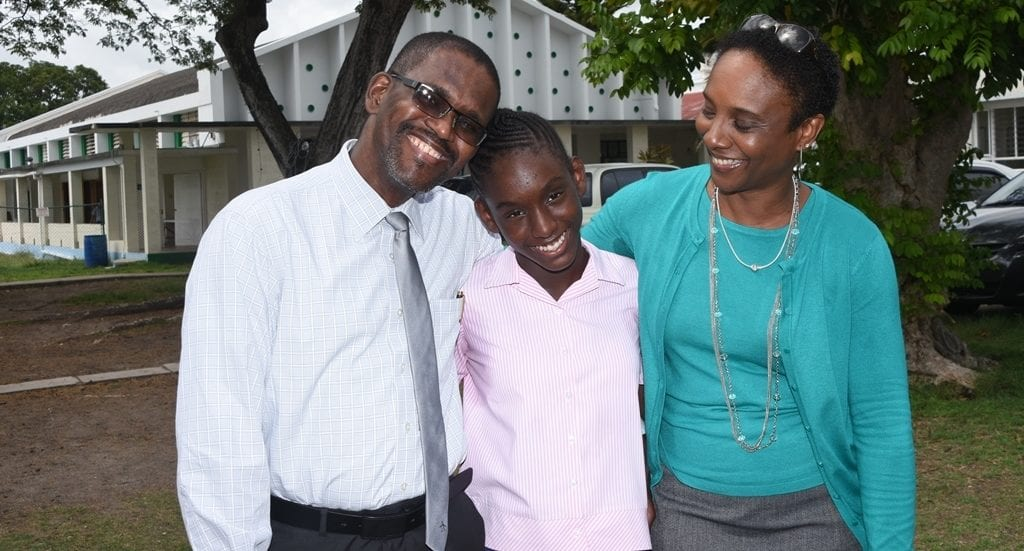 Top girl Adia Deane being congratulated by her parents Adrian and Kim Deane. (A.GASKIN/BGIS)
