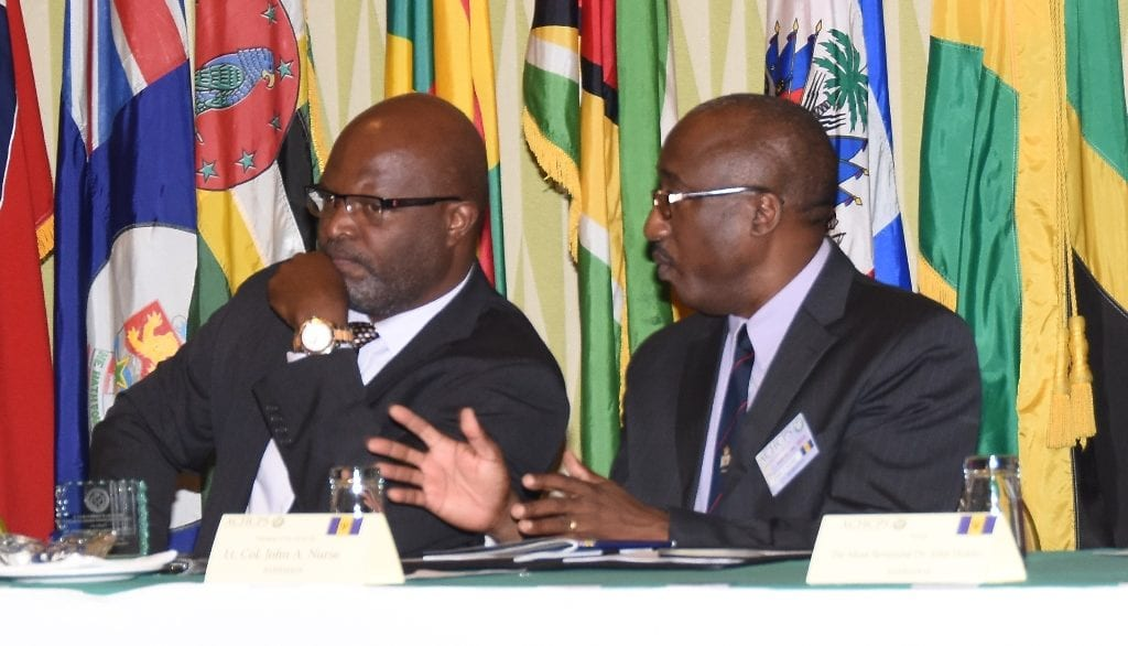 Attorney General, Adriel Brathwaite listens attentively to President of the Association of Caribbean Heads of Correction and Prison Services, Lieutenant Colonel John Nurse at the opening of the conference at Hilton Barbados yesterday. (C.Pitt/BGIS)