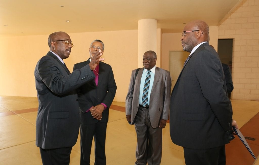 President of the Association of Caribbean Heads of Correction and Prison Services, Lieutenant Colonel John Nurse (left) has the attention of Anglican Bishop of Barbados, Dr. John Holder; Chief Justice, Sir Marston Gibson; and Attorney General, Adriel Brathwaite following the opening of the conference at Hilton Barbados yesterday. (C.Pitt/BGIS)