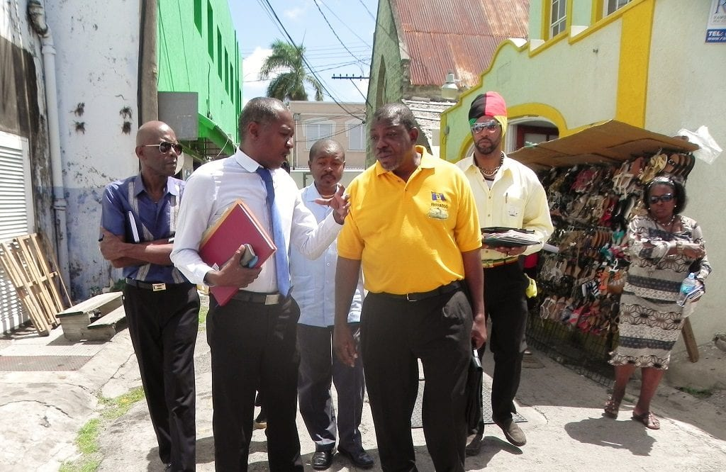 Manager of Markets, Sherlock King (white shirt) and BARVEN President, Allister Alexander (yellow shirt) during the walkabout in Bridgetown this morning. In the background are BARVEN members and Acting Senior Superintendent of Markets (centre), George Payne. (GP)