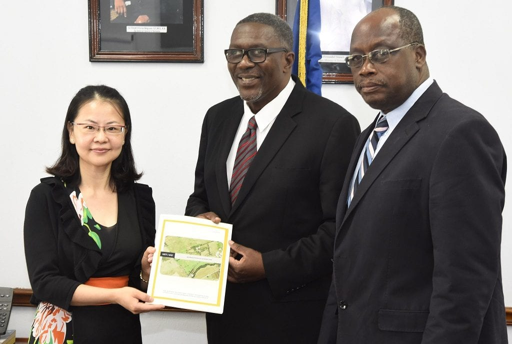 First Secretary, Embassy of the People's Republic of China in Barbados, Sun Nuzun; Acting Education Minister, Senator Harry Husbands; and Barbados Agricultural Society CEO, James Paul pose with a copy of the MOC at yesterday's signing ceremony. (E.Walker/MRD)