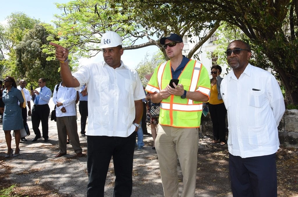 ourism Minister, Richard Sealy (left); Minister in the Office of the Prime Minister, Senator Darcy Boyce; and officials watch the start of the demolition phase at Sam Lord's Castle. (C.Pitt/BGIS)