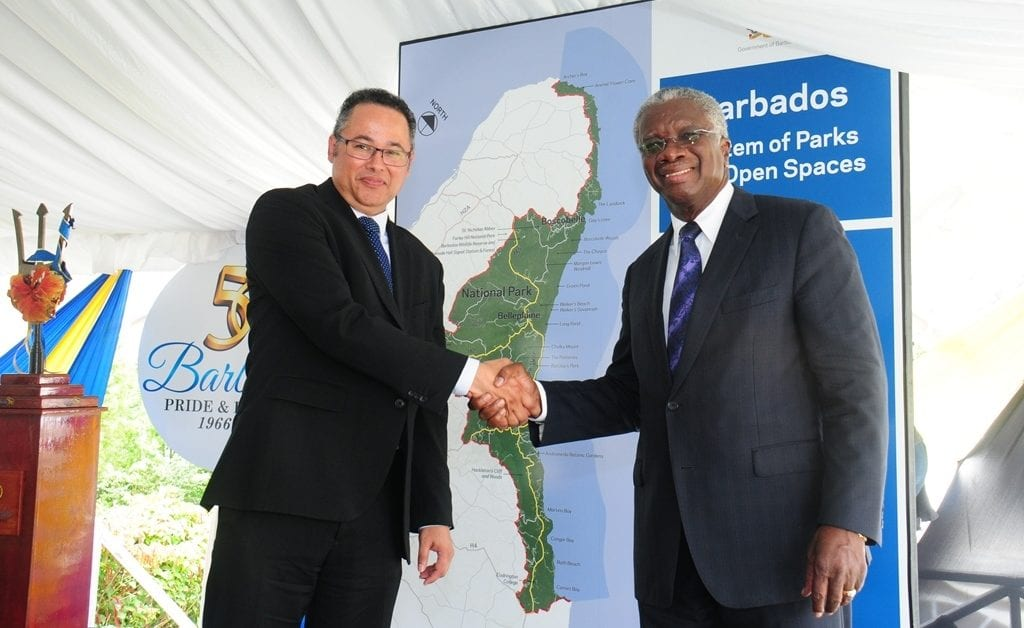 Prime Minister Freundel Stuart shaking hands with the Barbados Light and Power's Managing Director Designate, Roger Blackman following the unveiling of a gateway sign for the National Park this morning in St. Thomas. (B.Hinds/BGIS)