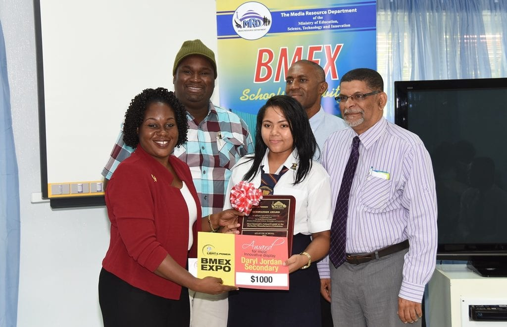 BL&P Communications Administrator, Jackie Marshall-Clarke presenting Saskia Singh of the Daryl Jordan Secondary School with their award while teacher, Ronald Worrell (in hat); BL&P Engineer, Roger Beckles; and Science Expo judge, Hallam Hope look on. (C.Pitt/BGIS)