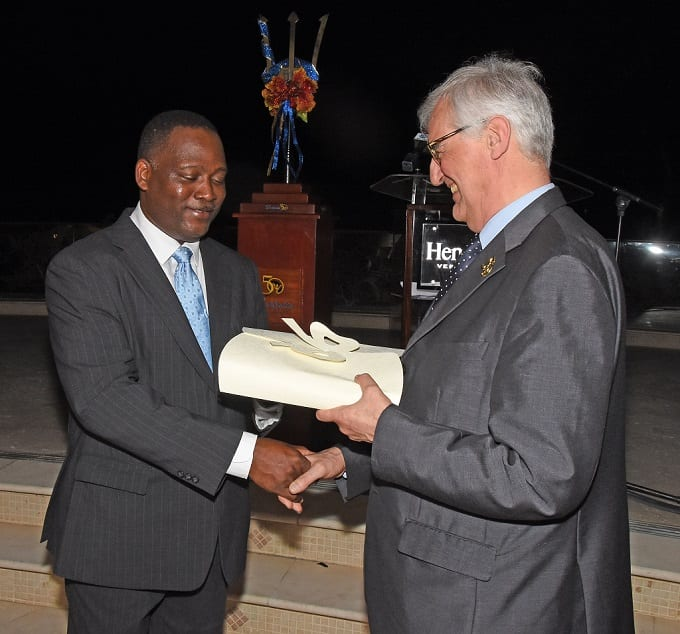 Industry Minister, Donville Inniss, presenting a token of appreciation to Hennessy Brand Ambassador, Maurice Hennessy at yesterday's function at Sandy Lane. (C.Pitt/BGIS)