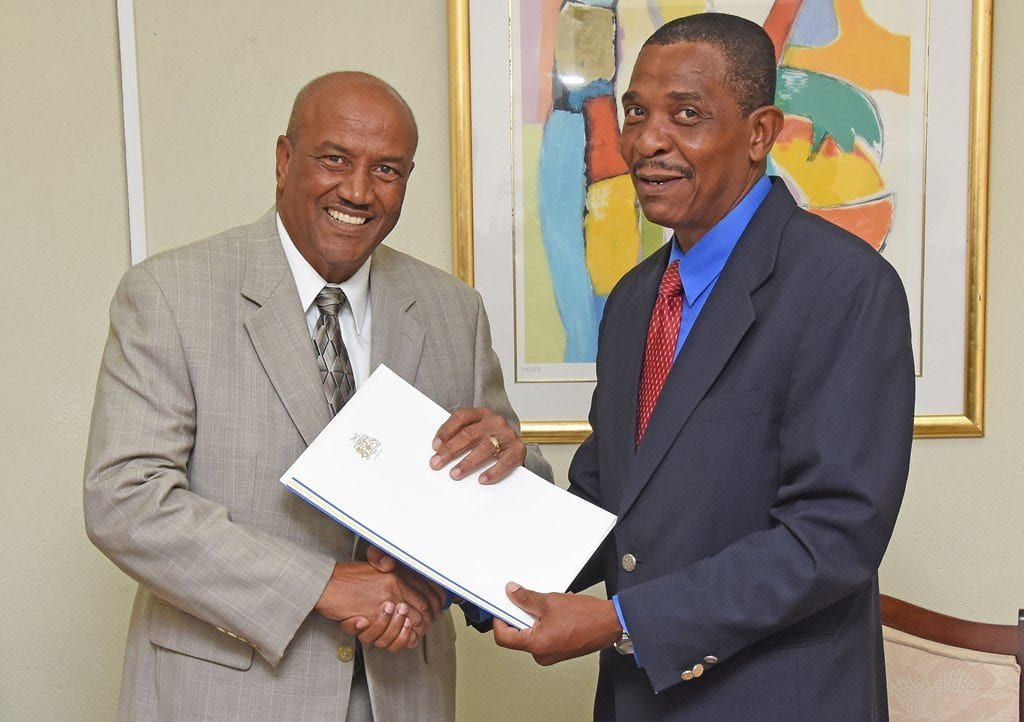 Chief of Protocol, Philip St. Hill (right) presenting the Exequatur and Commission of Appointment to South Korea's new Honorary Consul in Barbados, Roland Bullen. (C.Pitt/BGIS)