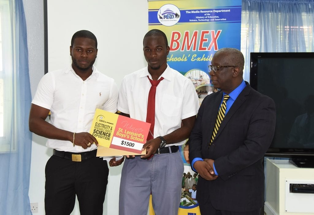 Education Minister, Ronald Jones, poses with teacher at the St. Leonard's Boys' School, Norman Gittens and student Jeremy Applewhaite. The school placed second in the Science Exposition. (C.Pitt/BGIS)