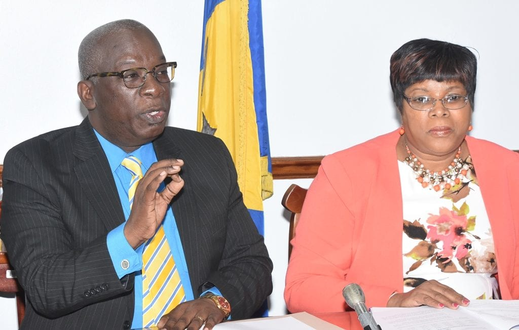 Education Minister, Ronald Jones addressing the media at today's press conference. Looking on is Chief Education Officer, Karen Best. (A.Gaskin/BGIS)