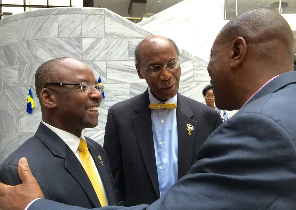 Culture Minister, Stephen Lashley being met by President of the Coalition, Tony Alleyne while at centre is Barbados' Honorary Counsul to Atlanta, Dr. Edward Layne. (GP)