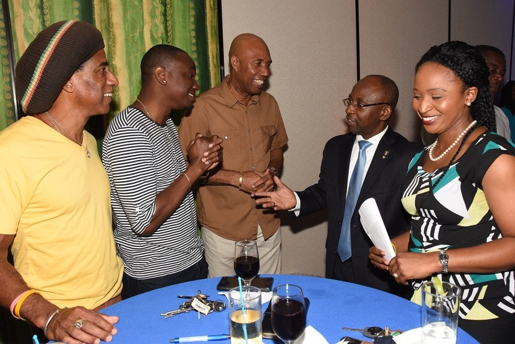 Culture Minister, Stephen Lashley chatting with artistes Aja, Ian Webster and Stedson Wiltshire while Barbados Today's CEO, Kaymar Jordan looks on. (C.Pitt/BGIS)