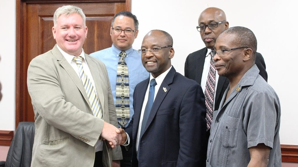 Sports Minister, Stephen Lashley shaking hands with EMERA's Vice President of Asset Management, David McGregor while (l-r) EMERA's Senior Business Development Officer, Roger Blackman; Interim CEO of Gymnasium Ltd, Jerry Blenman; and Housing Minister, Denis Kellman look on. (J.Weekes/BGIS)
