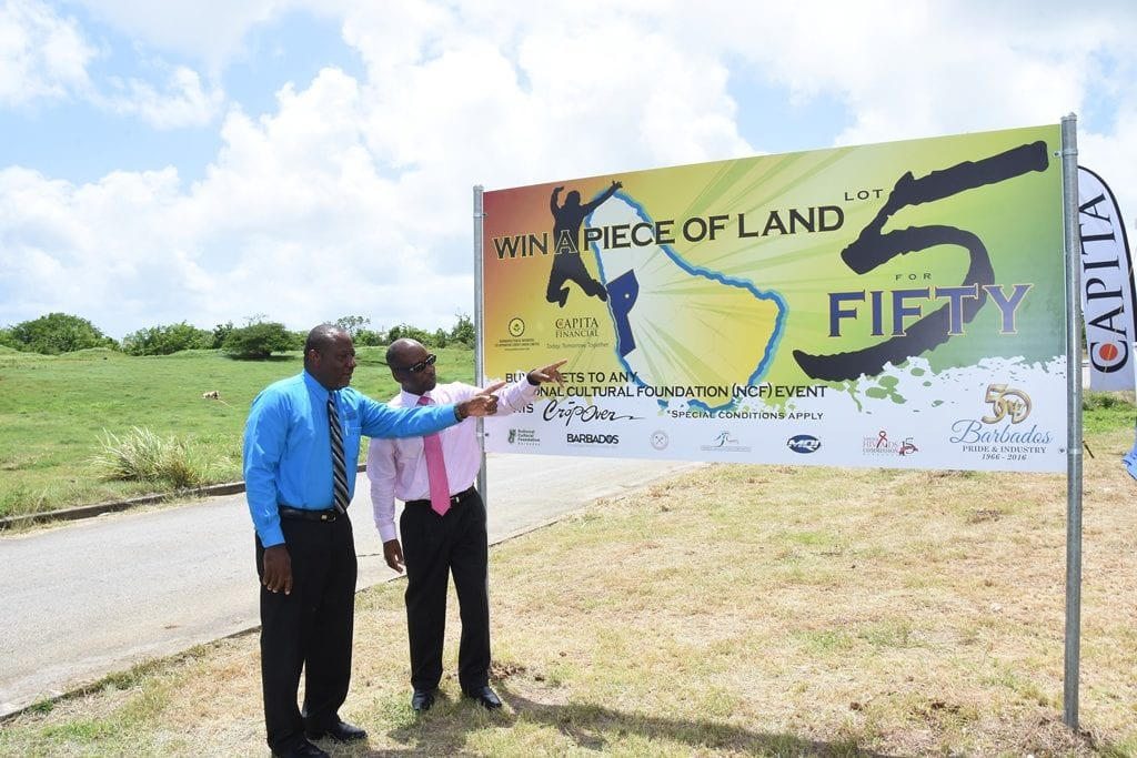 "Culture Minister, Stephen Lashley and President and Chief Executive Officer of Capita Financial, Paul Maxwell at the launch of the ""Lot 5 For Fifty"" promotion in Deanstown Terrace, St. James. (C.Pitt/BGIS)"