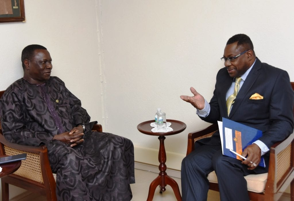 Acting Minister of Foreign Affairs, Steve Blackett in talks with Ghana's High Commissioner, John Akologu Tia. (C.Pitt/BGIS)
