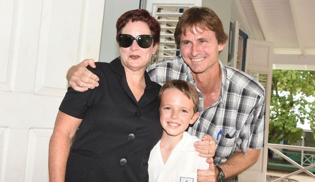 Top student Zachary Gill posing with his parents Gina and Andy Gill today following the announcement of the 11-plus results by the Ministry of Education. (A.Gaskin/BGIS)