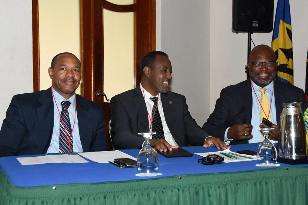 (Left to right) Secretary General of the Caribbean Postal Union, Allan Wayne Smith; UPU Director General, Bishar Hussein and Minister of Home Affairs, Adriel Brathwaite at the 3rd Council of Ministers of Postal Affairs Conference at the Accra Beach Resort. (C.Pitt/BGIS)