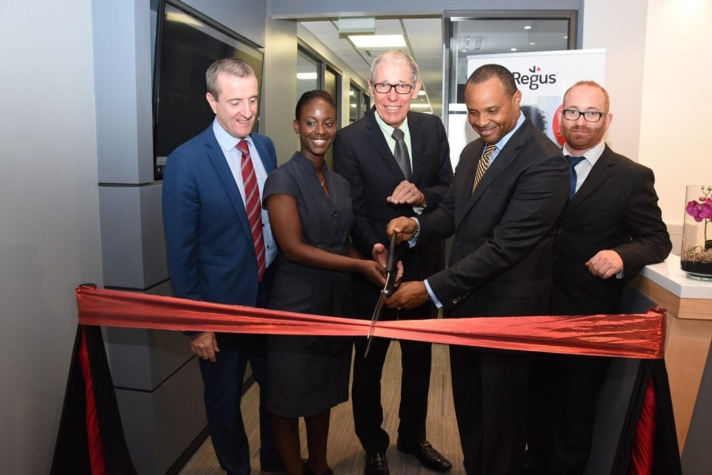 "Regus Managing Director, Mark Linehan; Customer Service Rep, Cheria Kippins; Businessman, Ralph ""Bizzy"" Williams; Finance Minister, Christoper Sinckler and Regus General Manager, Stuart May cutting the ribbon to officially launch the new Business Centre at One Welches, St. Thomas. (C.Pitt/BGIS)"