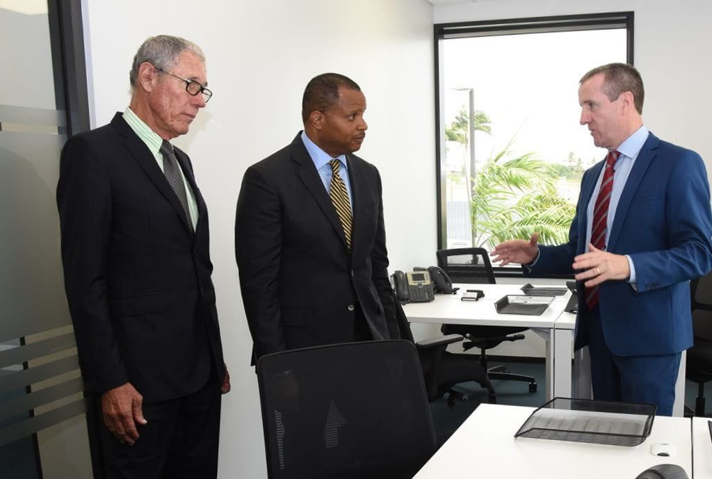 """Regus Managing Director, Mark Linehan (right) taking Finance Minister, Christopher Sinckler (centre) and Chairman of Williams Industries, Ralph """"Bizzy"""" Williams on a tour of the new business centre in St. Thomas on Tuesday. (C.Pitt/BGIS)"""