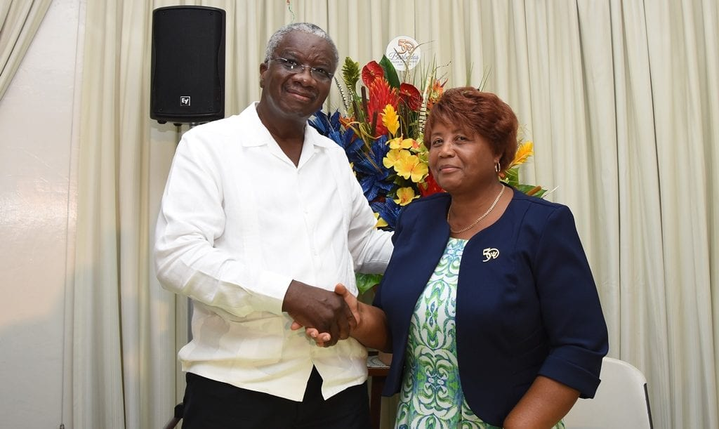 Prime Minister Freundel Stuart congratulating retired Cabinet Secretary, Lucene Wharton-Isaac on her distinguished career in the public service. (C.Pitt/BGIS)