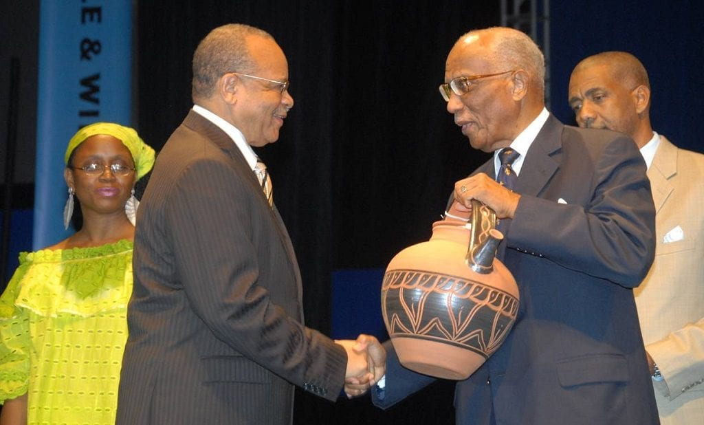 Dr. Jean Holder receiving the Governor General's Lifetime Award for his contribution to NIFCA from then Governor General Sir Clifford Husbands. (GP)