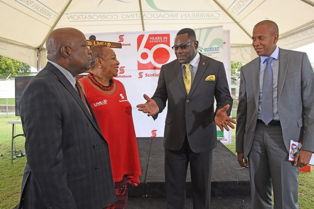 Social Care Minister, Steve Blackett has the ear of CBC General Manager, Doug Hoyte; CBMP Executive Director Dr. Allyson Leacock and Managing Director, Scotiabank, David Noel at the launch of Regional Testing Day 2016. (C.Pitt/BGIS)