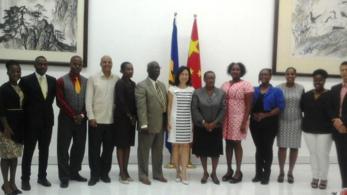 Minister of Education, Ronald Jones (sixth left); China's Ambassador to Barbados, Wang Ke (center); and Foreign Affairs Minister, Senator Maxine McClean (sixth right) pose with the 2016 Chinese scholarship winners. (M.Brathwaite/BGIS)