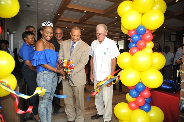 "Finance Minister, Christopher Sinckler (centre) and Barbados' calypso queen, Aziza, cutting the ribbon to officially open the new Burger King at Warrens today. Looking on is Chairman of the Williams Group, Ralph ""Bizzy"" Williams.(A.Miller/BGIS)"
