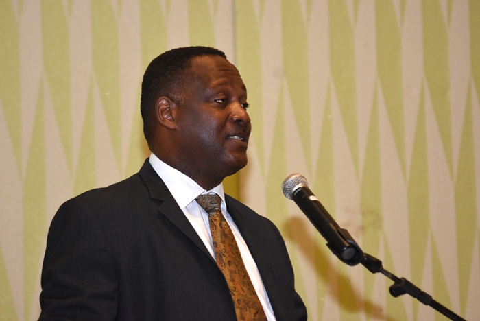 International Business Minister, Donville Inniss speaking at the annual International Business Workshop hosted by the Institute of Chartered Accountants of Barbados at the Hilton Barbados Resort. (A.Miller/BGIS)