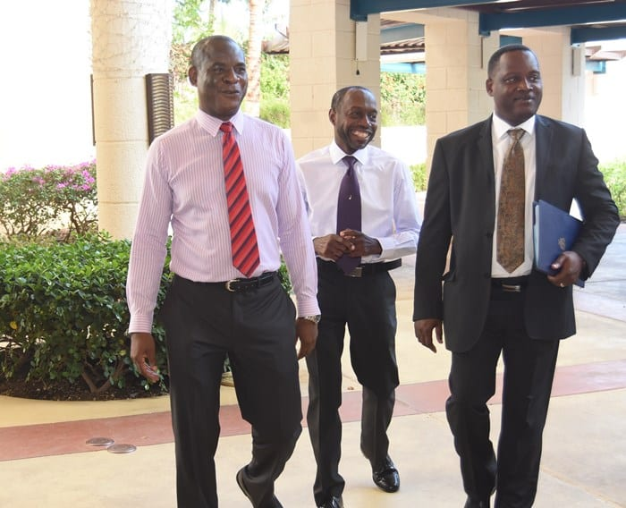 International Business Minister, Donville Inniss heading to the workshop at Hilton Barbados accompanied by ICAB Executive Director, Reginald Farley and immediate past president, Roger Arthur. (A.Miller/BGIS)
