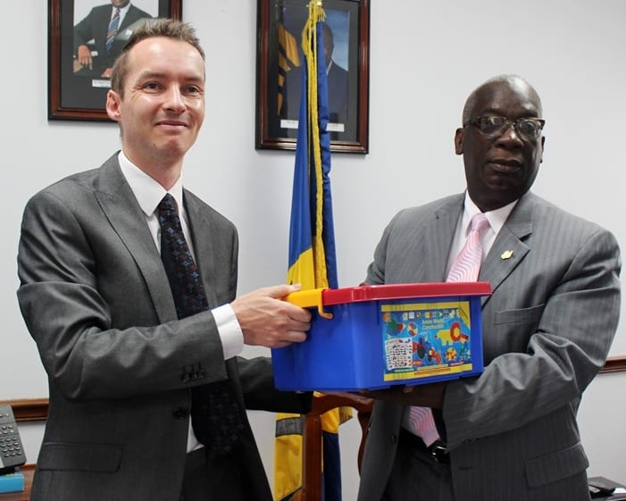 Head of Political, Press and Public Affairs at the British High Commission, Martin Robinson presenting a kit to Education Minister, Ronald Jones this morning at the Ministry. (Guest Photo)