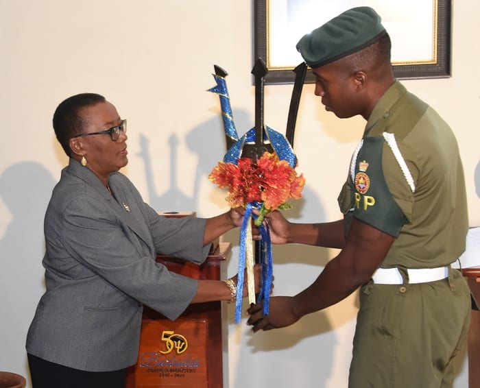 Minister of Foreign Affairs and Trade, Senator Maxine McClean, receives the ceremonial broken Trident at the Ministry's headquarters today, during a brief ceremony. (C.Pitt/BGIS)