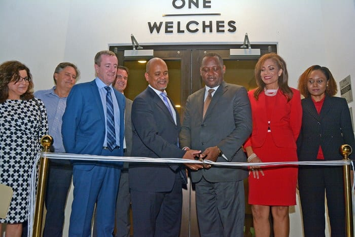 International Business Minister, Donville Inniss (third right) and Regional Leader of Transaction Advisory Services at Ernst and Young, Christopher Sambrano cutting the ribbon to officially open several new business offices at One Welches, St. Thomas yesterday while other officials look on. (A.Miller/BGIS)