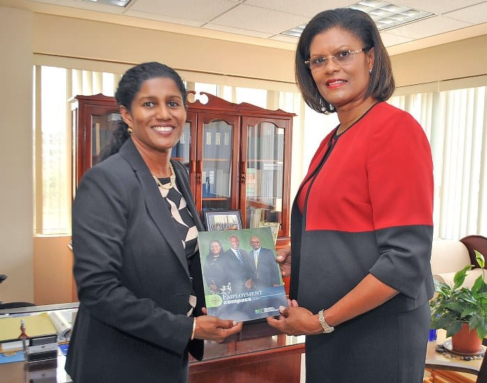 Minister of Labour, Senator Dr. Esther Byer Suckoo (left) receiving a copy of the publication Employment Compass from newly appointed BEC President, Marguerite Estwick recently. (A.Miller/BGIS)