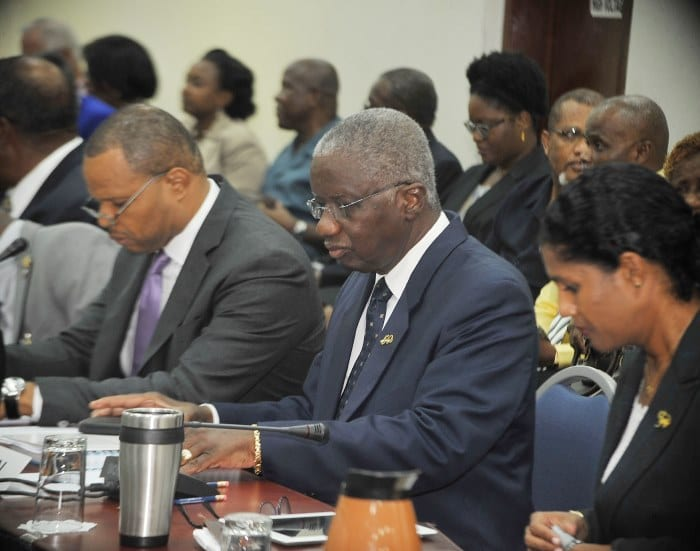 Prime Minister Freundel Stuart (centre) preparing for yesterday's Social Partnership meeting. To his right is Finance Minister, Christopher Sinckler and to the left is Minister of Labour, Senator Dr. Esther Byer Suckoo. (A.Miller/BGIS)