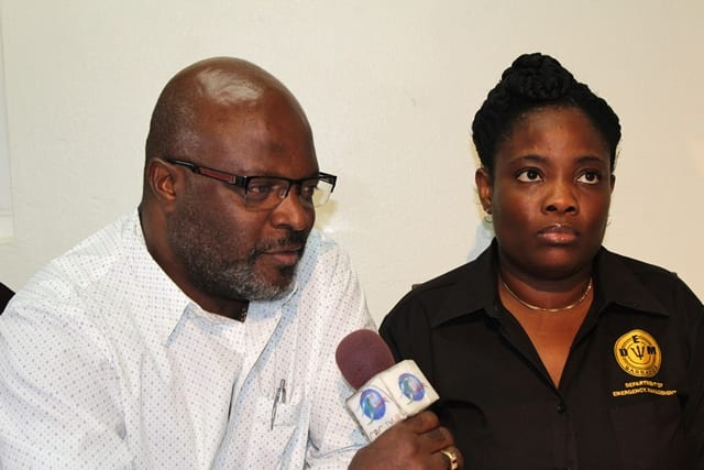 Attorney General and Minister of Home Affairs, Adriel Brathwaite and Director of the Department of Emergency Management (DEM), Kerry Hinds addressing the media during a briefing on Tropical Storm Matthew today. (A.Skeete/BGIS)
