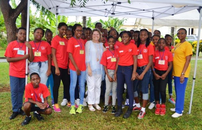 Campers attending Project S.O.F.T. 2016 surrounding Project Manager with the Sandy Lane Charitable Trust, Jacqui Cuke (centre) and Community Programme Officer at the NCSA, Makeada Bourne (right). (NCSA)