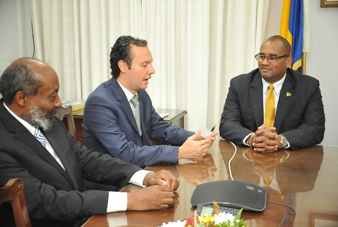 Mexican Ambassador to Barbados, Jesus Alberto Lopez Gonzalez, makes a point to Acting Prime Minister, Richard Sealy (right). At left is Mexico's Honorary Consul in Barbados, Sir Trevor Carmichael. (A.Miller/BGIS)