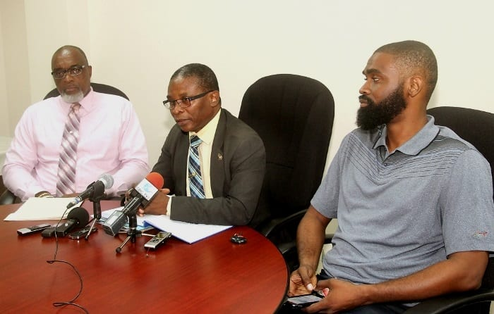 Minister of Housing, Lands and Rural Development, Denis Kellman (centre) speaking at today's press conference. Looking on are Co-chairs of Habitat III Committee - Chief Town Planner, Mark Cummins (left) and Economist, Jeremy Stephen. (C.Henry/BGIS)