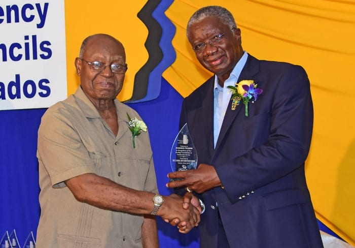 Prime Minister Freundel Stuart presenting Reginald Pilgrim with an award for his sterling contribution to community service at the St. Michael South Constituency Council's Community Awards Ceremony on Saturday. (C.Pitt/BGIS)