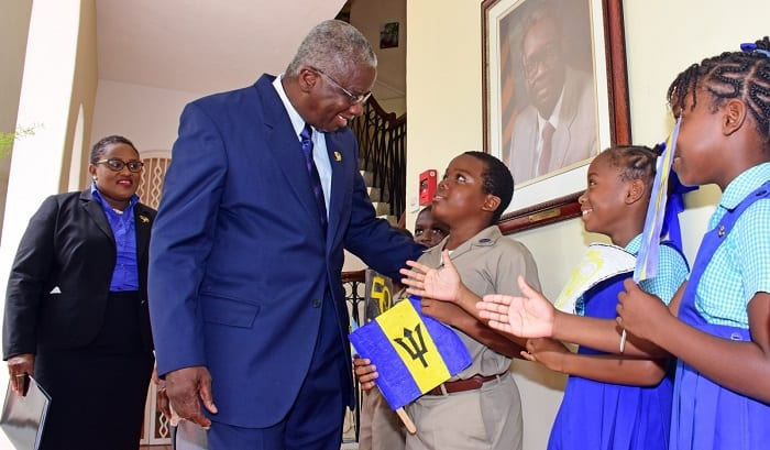 Prime Minister, Freundel Stuart greets students on his way to a press conference at Ilaro Court. The briefing was to give an update on the activities for the 50th Anniversary of Independence. To the left is Permanent Secretary, National Independence Secretariat, Gabrielle Springer. (C.Pitt/BGIS)