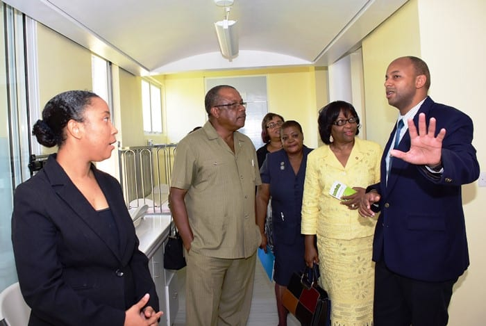 Medical Officer of Health, Dr. Omar Edwards (right) and Dr. Elizabeth Madeville-Babb (left) taking Health Minister, John Boyce (second left) and PAHO Director, Dr. Carissa Etienne (second right) on a tour of the David Thompson Health and Social Services Complex recently.(C.Pitt/Henry)
