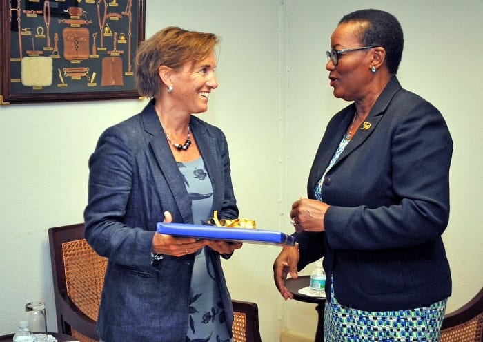 Minister of Foreign Affairs and Foreign Trade, Senator Maxine McClean presenting a gift to Canada's new High Commissioner to Barbados, Marie Legault at their recent courtesy call. (A.Miller/BGIS)