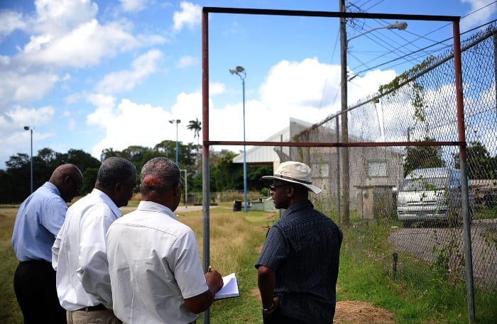 Sports Minister, Stephen Lashley (right) and Interim National Sports Council, CEO. Jery Blenman and officials touring sports facilties across the island arlier this year. (FP)