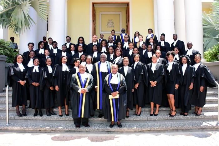Chief Justice Sir Marston Gibson (centre), Court of Appeal judges, judges and magistrates pose with the new lawyers admitted to the Bar at the Supreme Court. (C.Pitt/BGIS)