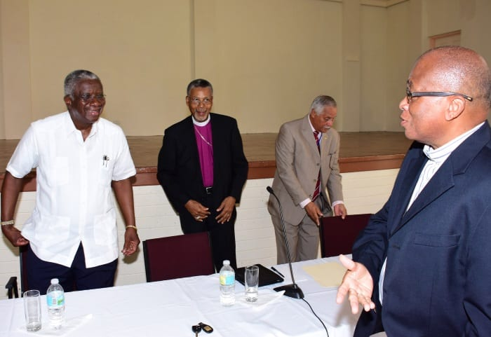 Prime Minister Freundel Stuart chatting with Rev. Canon Wayne Isaacs (right) while Archbishop of West Indies & Bishop of Barbados, Dr. John Holder and former Executive Director of the Barbados Family Planning Association, George Griffith. (C.Pitt/BGIS)