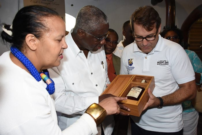 Managing Director of Mount Gay Distilleries, Raphael Grisoni showing the special 50th anniversary XO Cask Strength Limited Edition to (from left to right) Director of the Barbados Museum and Historical Society, Alissandra Cummins; Prime Minister Freundel Stuart; and Minister of Housing and Lands, Denis Kellman. Looking on are Commerce Minister, Donville Inniss and Opposition Leader, Mia Mottley (both partially hidden). (C.Pitt/BGIS)