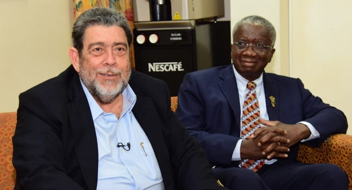 Chairman of the Majority Shareholder Governments of regional air carrier LIAT, Dr. Ralph Gonsalves speaking to reporters at yesterday's media briefing at the Lloyd Erskine Sandiford Centre while Barbados' Prime Minister Freundel Stuart looks on. (C.Pitt/BGIS)