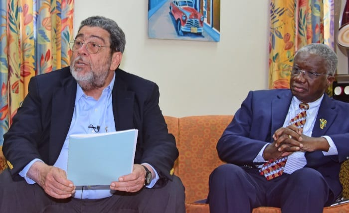Prime Minister of St. Vincent and the Grenadines and Chairman of the Majority Shareholder Governments of LIAT,, Dr. Ralph Gonsalves speaking at yesterday's press briefing at the Lloyd Erskine Sandiford Centre while Barbados' Prime Minister, Freundel Stuart listens attentively. (C.Pitt/BGIS)