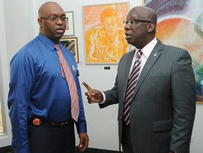 as Deputy Chief Education Officer with responsibility for Planning and Development, Dr. Roderick Rudder (left) in discussion with Minister of Education, Ronald Jones. (FP)